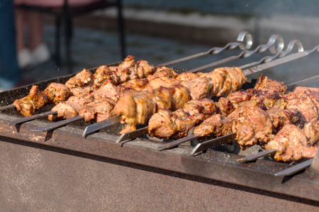 street food skewers, meat is fried on the fire, the process of cooking meat on the fire