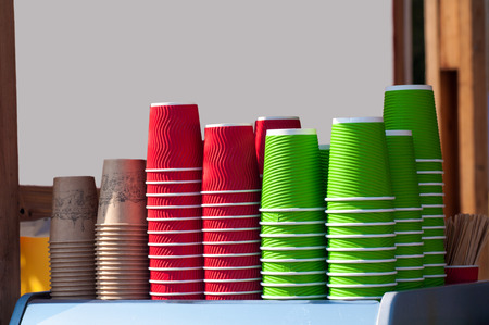colored, paper cups for coffee, red, green, yellow. Free space for text Фото со стока