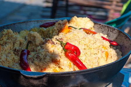 rice with meat, national Uzbek cuisine, national dish of pilaf, street food during the festival