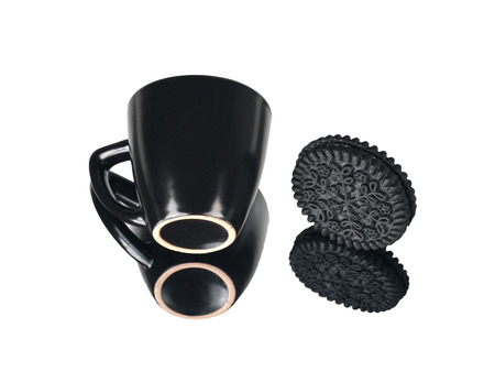 black cup and black round cookies with reflection,isolated Фото со стока