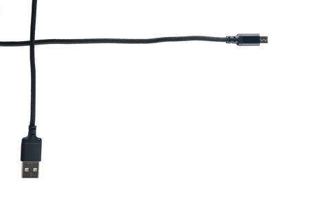 USB cable and mini close up on white Фото со стока