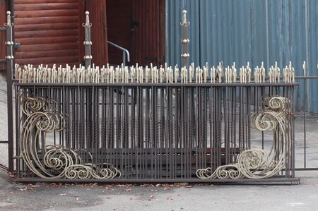 forged lattice fence with pattern elements Stok Fotoğraf - 129831402