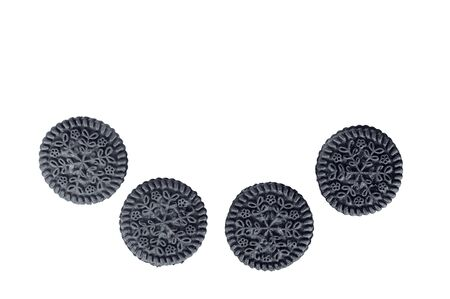 four round black cookies on a white background isolated