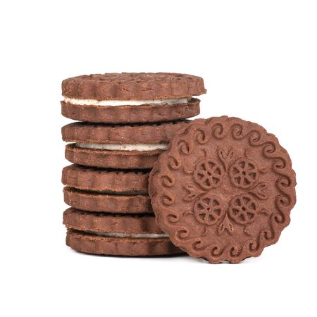 brown chocolate round cookies in a stack isolated on white background