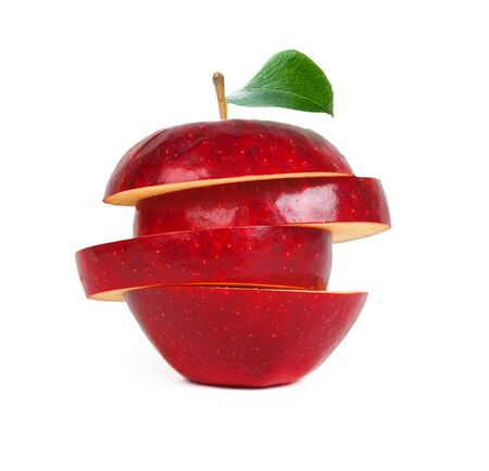 red apple with a green leaf, oval slices, even cuts across across isolated on a white background