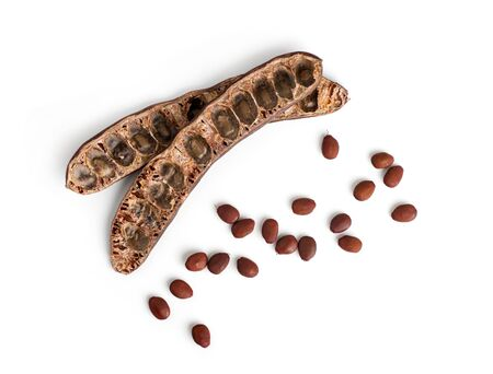 top view carob with scattered seeds isolated on white background