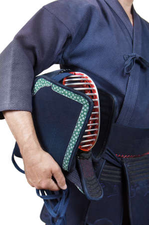 sportsman and protective equipment 'bogu' for Japanese fencing Kendo training close-up Standard-Bild