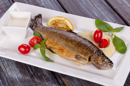 fried trout with mashed potatoes