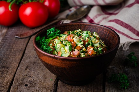 tabbouleh: Fresh tabbouleh, a Middle Eastern salad, in a bowl