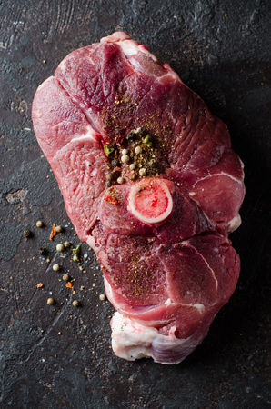 dark meat: Raw Mutton meat with east spice on dark background Stock Photo