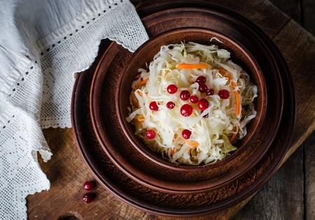 Sauerkraut with berries on rustic background Stock Photo