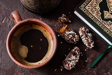 Breakfast in arabian style with fresh coffe cup and dates