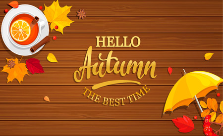 Hello Autumn banner on wooden background.