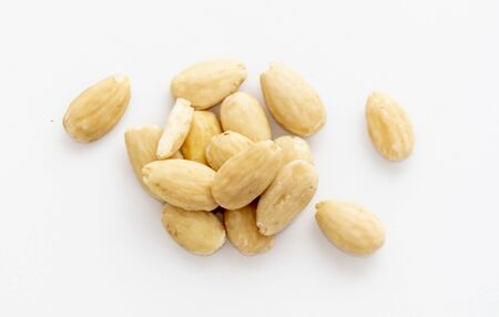A handful of raw natural hazelnuts on white background.