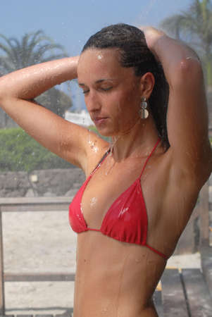 EASE: Woman taking a shower in the beach