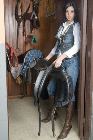 woman working in an stable with horses seats