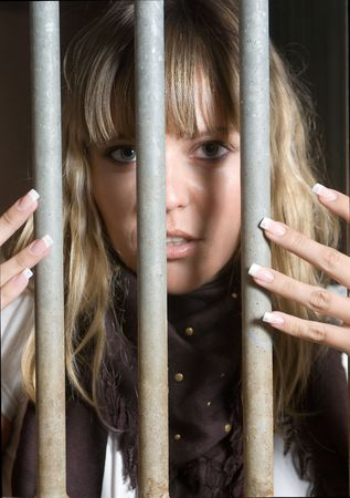 chased: woman in a jail of her hearth