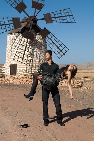 muscled: muscled man in black with a woman in arms