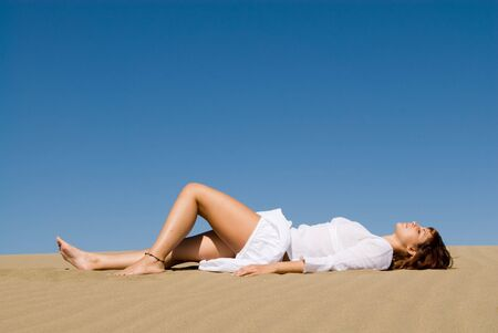 woman lying in the sand relaxing