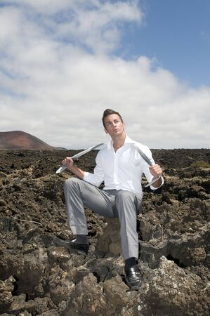 hardworker: angry and stressed businessman on the vulcan stones Stock Photo