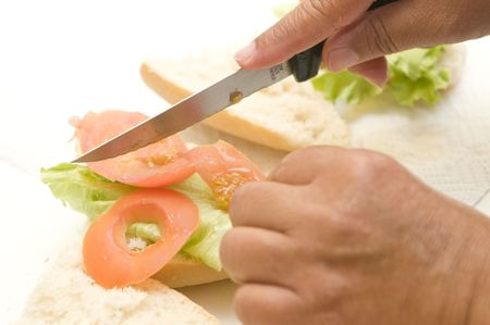vegetal: two hands making a vegetal sandwich Stock Photo