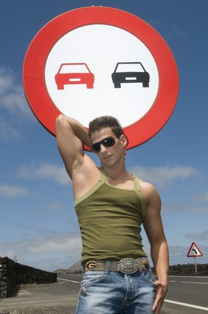 trafic: beautiful and sexy man over a trafic signal