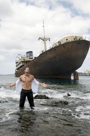 wreckage: man with abandoned ship under the sky