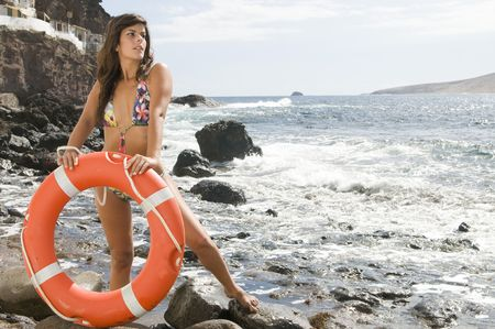 beautiful liverguard in the beach with an orange lifebuoy photo