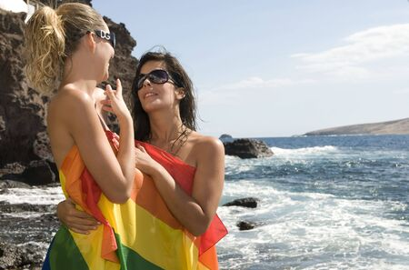 couple of women in love with lesbian rainbow flat Stock Photo