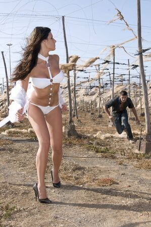 prostitution: violation of a woman in desolated landscape