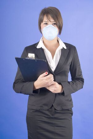 dust mask: executive woman with protective mask for swaine flu or others