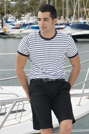 sexy gay: beautiful sailorman wearing sailor clothes in a yatch Stock Photo