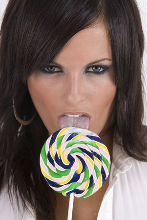 sexy and cute blond female posing with candy lollypop