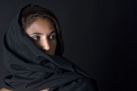 arabian woman with black vell in black background photo