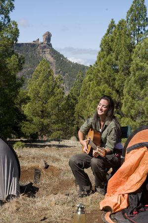 countrylife: woman in camping playing guitar