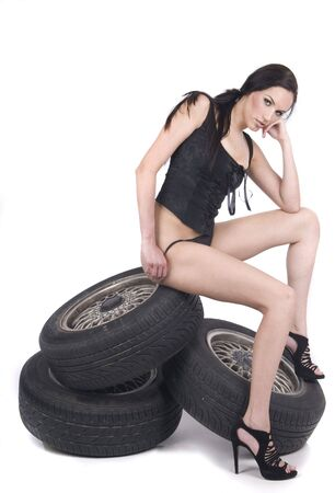 woman in lingerie over white with wheels Stock Photo