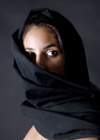 arabian woman with black vell in black background