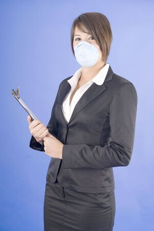 dust mask: executive woman with protective mask for swaine flu or others Stock Photo