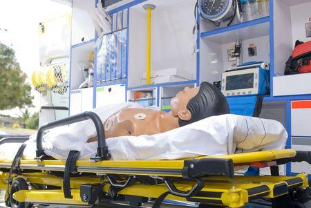 emergency vehicle: ambulance equipment in emergency vehicle with dummy Stock Photo