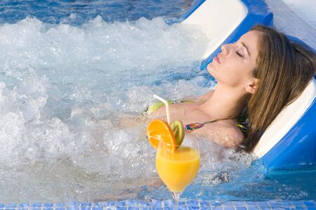 woman relaxing in a water bed in an spa