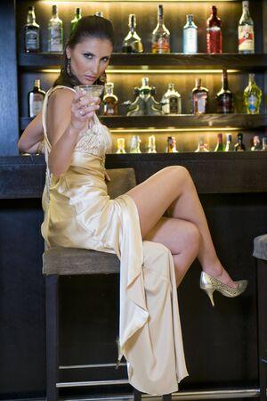 pretty woman drinking in a bar