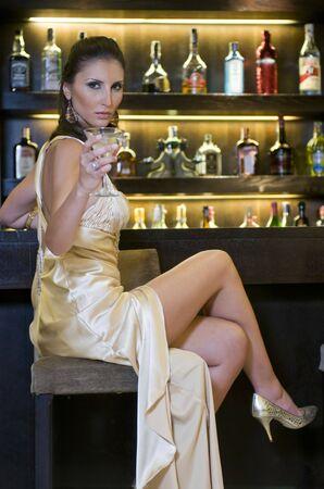 pretty woman drinking in a bar photo