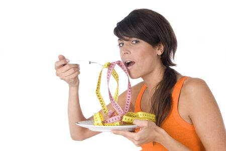 woman diet eating a tape measure Stock Photo
