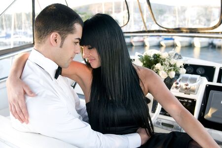 elegant couple in a yatch Stock Photo