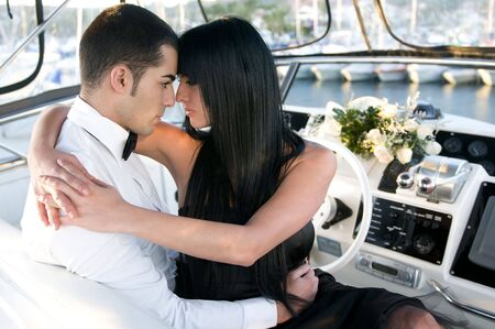 elegant couple in a yacht  photo
