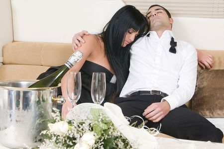 couple after a new year party tired  photo