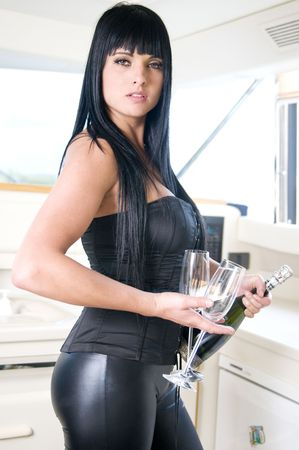 young sexy woman with champagne bottle in new year party or other Stock Photo