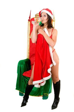 sexy woman wearing santa claus noel clothes with armchair Stock Photo - 6327861