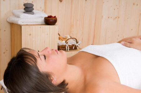 beautiful woman in a sauna or relax massage session photo