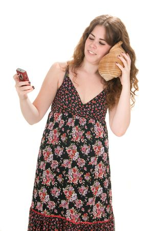 earing: woman earing the sea with marine conch and talking by phone